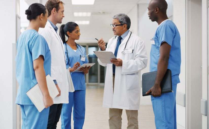group of medical professionals having discussion